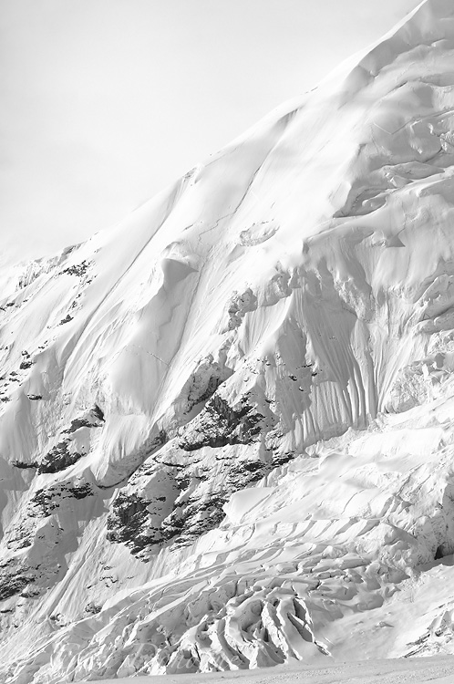 Mt Jarvis and its glaciated face, covered under a fresh snowfall, in black and white photo. Wrangell Mountains, Wrangell - St. Elias National Park and Preserve, Alaska.