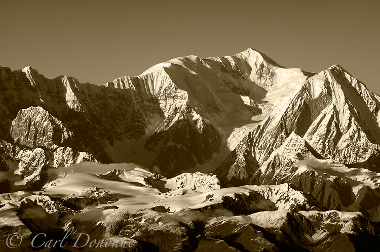 Late afternoon light strikes Mt. Bona - black and white photo.