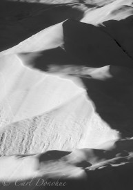 Black and white photo of snow covered moraine on the Root Glacier, Kennecott, winter, Wrangell - St. Elias National Park, Alaska.