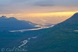 A gorgeous sunset glows over the Bremner and Copper River Junction in the Chugach Mountains, Wrangell St. Elias National Park, Alaska.