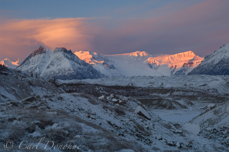 Donoho Peak, in the Wrangell Mountains, and Stairway Icefall. The Root and Kennecott Glaciers, moraine, fresh dusting of snow, winter. Wrangell St. Elias National Park, Alaska.