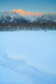 Fireweed Mountain and frozen lake, winter, alpenglow in the evening, Wrangell - st. Elias National Park and Preserve, Alaska.