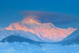 Mount Blackburn on a cold winter dawn, glowing with that gorgeous winter alpenglow. Wrangell - St. Elias National Park, Alaska.