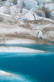 A small blue tarn on the Tana Glacier, Wrangell - St. Elias National Park, Alaska.
