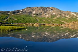 Reflection of the Chugach Mountains near Iceberg Lake, in Alaska's Wrangell - St. Elias National Park and Preserve.