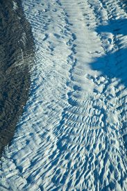 Crevasses and moraines make patterns in the Root Glacier, near Kennicott and McCarthy, Wrangell-St. Elias National Park, Alaska - aerial photo.